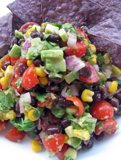 Black Bean, corn and avocado Salsa... Delicious as a dip and as a garnish for seafood, pork, steak and chicken and as a topping for any Mexican dish