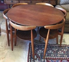"Vintage Danish Modern dining table and chairs designed by Hans Wegner for Franz Hansen. 3-legged table is oak and laminated teak, 47"" diam. x 28"" high. Six ""Heart Chairs"", also oak and teak with 3 legs, 18"" x 18"" x 29"". Made in Denmark: 1950s."
