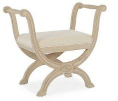 Sienna Carved X-Base Dressing Stool Ottoman, White Linen -- This French-inspired stool has a gently curved frame, off-white linen upholstery, and a sturdy birch frame with a weathered gray finish.