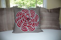 Flower pillow.  She has tutorial for making the petals.