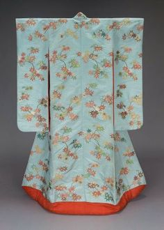 Kimono (uchikake)  Japanese, Meiji era, late 19th or early 20th century, Long-sleeved outer robe (uchikake) with overall design of maple leaves in red, pink, yellow, green and brown silk and gilt paper strip discontinuous supplementary patterning wefts on a light blue twill-weave silk ground; lined with bright red damask and padded at the bottom. Much of Bigelow's collection of Asian art was formed during his residence in Japan between 1882 and 1889. MFA