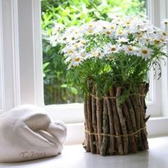 hot glue sticks to a tin can to create a unique flower vase, with a defined rustic look