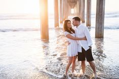 La Jolla Beach Engagement Session at Scripps Pier—Modern Romantic Engagement Photos- San Diego Wedding Photography  - for more ideas and wedding & engagement photography inspiration, check out my blog! www.britjaye.com/blog #sandiegoengagementphotography #engagementphotography #engagementphotos #weddingphotographer