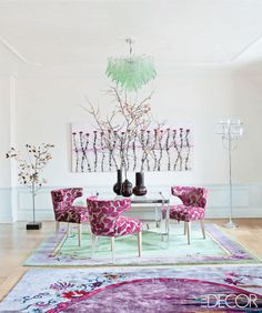 The games area features an artwork by Jean-François Debongnie, the chairs are upholstered in a Designers Guild fabric, and the tree sculpture is a C. Jeré piece; the vases are by Robert Kuo, and the rugs are Chinese Art Deco.