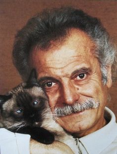 Georges Brassens, French singer songwriter, poet and cat lover. I love cross eyed cats, so cute.