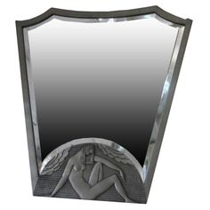 French Art Deco Carved and Silvered Geometric Wall Mirror, silver painted wood and beveled glass, 1920's (wonderful example of classic art deco)