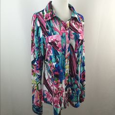 "Vertigo Multi Color Floral Print Button Shirt Excellent condition. Bright floral print. Logo gold snap button closure. Shoulder tabs. Flap pockets. SZ L, but seems to fit M better. Material: no label, could be polyester. Approx measurements taken with item laying flat-no stretching-on one side. Bust(armpit to armpit): 18.5-19"". Length: 25.5"" not incl collar. Sleeve: 26"". Shoulder: 15"". Item:pma8.   1 business day handling - FAST SHIPPING. Vertigo Paris Tops"