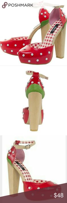 Strawberry Lips Platform from Iron Fist Sweet strawberry kisses to all our fave Iron Fist babes! This is the perfect pair of heels for a picnic in the sunshine, with the wicker look chunky heel and trim, and bright red strawberry design. We've added some extras pretty with lots of pearl studs and applique too!   Chunky Heel Ankle Strap Pearl Embellishments Platform Heel WIDTH: 135mm HEIGHT: 30mm Iron Fist Shoes Platforms