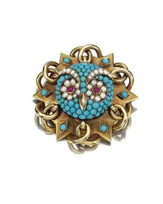 A gold brooch designed as a stylised six-pointed star, applied with cabochon turquoise and seed pearls depicting the face of an owl, its eyes embellished with cabochon rubies - MID TO LATE 19TH CENTURY