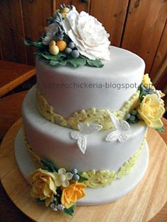 two tier fondant wedding cake with yellow an white gumpaste flowers