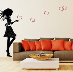 Wall sticker girl blowing hearts.