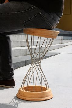 Syn-Kraft Furniture by Christian Kayser. German designer and recent grad Christian Kayser's work focuses on the idea of synergy, using gravity and weight to determine the final shapes. The stool, made of a wooden frame connected by flexible steel batons, changes shape when the user sits on it, creating a symbiotic relationship between the user and the object.