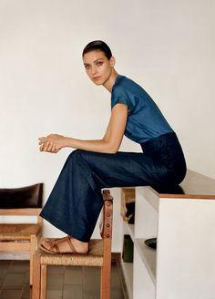Hermès - Vestiaire d'Eté 2013 PANTS High waisted indigo linen pants, short sleeve linnn shirt and brown leather sandals. Photo : Alasdair McLellan.  #hermes #fashion