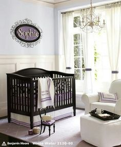 Adore this purple and white nursery!!