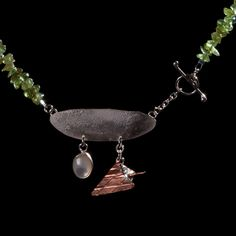 Summer at the seaside necklace Unique handmade silver necklace.  A mother of pearl cabuchon set by hand in silver and a handmade copper and silver icecream cone hang from a 'driftwood' silver pendant suspended on a necklace of peridot chips with a handmade and hammered silver toggle and ring fastening.