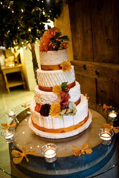 Each layer of the carrot cake had a different texture, but was tied together with the orange ribbon and cascading fall flowers. The cake was placed on an old wine barrel to add that wine country feel in the room.