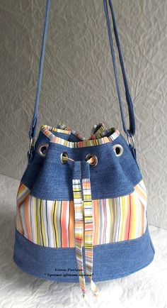 Denim grommet tote bag --- link goes to a large version of the picture - NO PATTERN. Recycled jeans, jeans bucket - bag - just the picture I think I will combine jeans with crochet, says Centina K. Love the play of recycled denim and stripes DIY Handmad Patchwork Bags, Quilted Bag, Patchwork Patterns, Sewing Patterns, Jean Purses, Purses And Bags, Sacs Tote Bags, Diy Sac, Denim Handbags