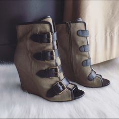 ASH Khaki Canvas & Leather Wedge Booties 36 Excellent condition pre-owned ASH ankle booties in size 36 or 6  A huge ASH fan that I am, these booties are one of the most coolest pairs I've own. They retailed for about $300 and looked so sexy with leggings or mini skirt. Khaki canvas with black leather trim and straps, decorated with weathered-gold buckles. Comes with original box. Ash Shoes Ankle Boots & Booties
