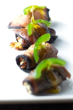 Stuffed Dates Wrapped in Bacon. Easy and delicious party starter. Pin it for the Holidays!  http://www.themediterraneandish.com/stuffed-dates-wrapped-bacon/