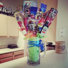 Man boquet for Fathers Day! Mug, tissue paper, wooden skewers, scratch off lotto ticket, mini liquer bottle, sunflower seeds, chapstick, altoids.