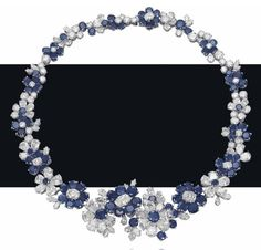 A superb sapphire and diamond flower necklace, by Bulgari. Photo Christie's Image Ltd 2013 Designed as a series of graduated. Sapphire Necklace, Sapphire Jewelry, Diamond Pendant Necklace, Sapphire Diamond, Diamond Jewelry, Diamond Necklaces, Blue Sapphire, Ruby Pendant, Gold Necklaces