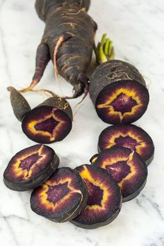 """natureisthegreatestartist: """"What in the world is this? It's an heirloom carrot called Turkish Black. Bizarre and beautiful, yes? """" Wonder if it's spicy, like the other dark carrots? Unusual Plants, Cool Plants, Fruit And Veg, Fruits And Vegetables, Permaculture, Vegetable Garden, Garden Plants, Black Garden, Edible Garden"""