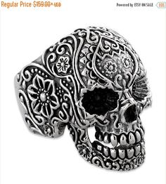 Beautiful 925 Sterling Silver Skull Biker Ring. This floral design ring is full of intricate detail. It is high polished and hand painted to bring out the detail. It is made in USA and is available in all sizes.    About Us:  We are one of the largest biker ring manufacturers in the United States. All jewelry is manufactured on site in our factory. This is how we can give you one of the competitive prices in the industry. There are no middle man, so you get the best prices possible. All…