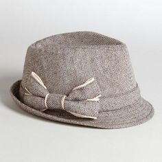 No matter where you wear it, our vintage-inspired Brown Bow Tweed Fedora Hat completes the look of your ensemble. Featuring classic tweed, a chic silhouette and an elegant brown ribbon, this exclusive hat is a must-have for your accessory collection.