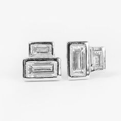 Minimalist baguette diamond earrings using repurposed vintage diamonds. Turn them either way to customize your look. Eco friendly, affordable and available in all gold colors from Anueva Jewelry.