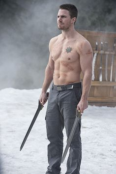 Oh. My. God. Arrow, great tv, sword, powerful face, intense eyes, beard, eyecandy, steaming hot, warrior, photo