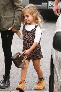 Penelope Disick wearing Louis Vuitton Monogram Canvas Mini Hl Speedy Bag and Timberland Kids 6 Premium Waterproof Boot Core