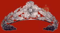 A tiara of leaves & a central flower in diamonds, signed Mellerio. When exhibited at the Paris International Exhibition of 1867, it was admired by Princess Maria Clotilde of Savoy, who suggested it to her father. It was bought by King Victor Emmanuel II for his daughter-in-law, Princess Margherita of Savoy-Genoa, for her marriage to Prince Umberto of Piemonte in 1868. It was sold by  King Umberto II and Queen Maria José's daughter & today it's in the possession of Albion Art in Tokyo.
