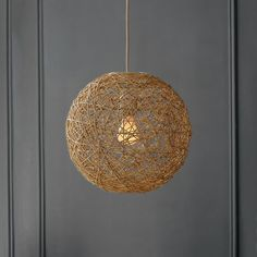 """For an owl theme, a natural """"nest"""" looking lamp might be fun. Too bad West Elm doesn't sell anymore."""