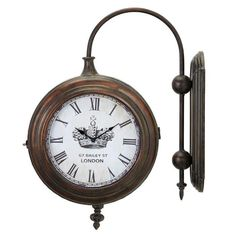 Add a classic touch to your home office or entryway with this wall-mounted clock, showcasing a train station-inspired design and an antique brass finish.