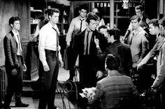 Bernardo (Geroge Chakiris) visits the candy store to warn Tony (Richard Beymer) to stay away from his sister, Maria.