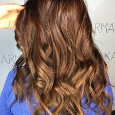 These luscious #auburn #waves are the perfect for when you want to bring the warmth of the #beach wherever you go.   Make sure to #protect your #haircolor and maintain #moisture by using our hydrate cleanse and conditioners! Hair by @karir_karmasalon.  Make sure to TAG #usmooth for your chance to be featured on our page!