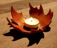 Autumn Leaf Bowls - the clay is curled over a bowl to dry - from Lightly Enchanted (,) click the link now for more info. Diy Clay, Clay Crafts, Gourd Crafts, Clay Candle Holders, Handmade Candle Holders, Handmade Candles, Diy Candles, Leaf Bowls, Clay Bowl