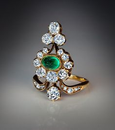 A Belle Epoque Antique Diamond and Emerald Ring Russian, circa 1890 This elaborately designed 19th century ring features a beautiful cabochon cut emerald (approximately 1 carat)  and 23 old cut sparkling white diamonds (estimated combined weight 3 carats, color F-G, clarity VS2-SI1) A superb ring with excellent gemstones. Height - 28 mm (1 1/8 in.) US ring size - 7  (18 mm) the ring can be sized $17,500.00