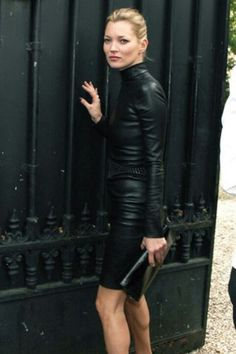 Kate Moss dressed in black.