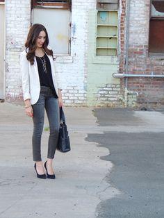 Business casuals: white jacket, black blouse, med wash denims, blue shoes and blue bag