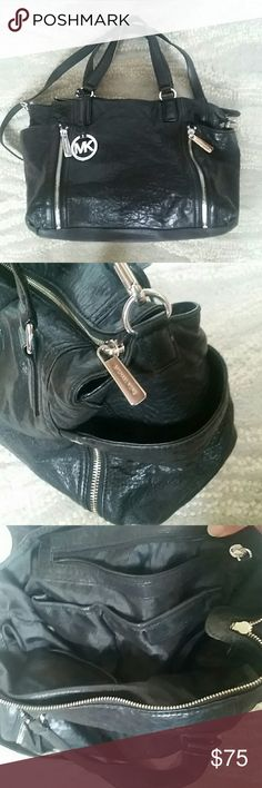 """Large Michael Kors Leather Shoulder Bag In excellent condition, this roomy bag can hold a LOT of stuff. Zippered details, side pouches, and lots of pickets inside! Leather has been well cared for and conditioned in a, smoke free, pet free home. The only blemish is slight fading at bottom of liner from cleaning. 17""""W x 11""""H . Bag is very deep, as shown in last pic. Michael Kors Bags"""
