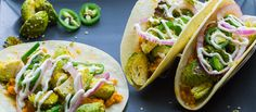 Protein-packed vegan tacos with red lentils, Brussel sprouts, & pickled onions & jalapeños.