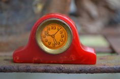 Red Swirl Bakelite/Catalin Mantle Clock Pencil by bibliocycle,