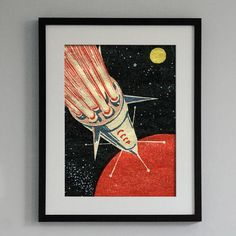 Made in Britain A super striking print of a Soviet Rocket. Based on a classic design from a vintage Russian matchbox, this roaring rocket print harks back to the early days of the space race. We really love the strong colours on this image and the textured retro style is enhanced by the printing on heavyweight art paper. This print makes a great gift for lovers of space, science and timeless vintage style! Check out the close-up detail picture above for a better look. This print is one of a…