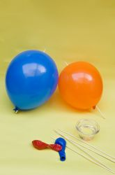skewer balloons science experiment in polymers.  Skewer sticks dipped in veg. oil can be pushed through inflated balloons without popping them.  How many can you poke through before deflating it?