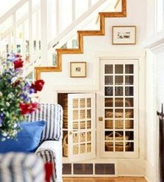 Check out link to see ideas for using space under stairs...