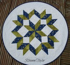 Carpenter Star Table Toppers | @ The Nifty Stitcher  ... Would be FABULOUS in Christmas-sy fabrics/colours for a table topper ... or made even smaller for placemats!!!  LOVING the quilting in them too!!!  Such inspiration from Rhiannon once again!!!