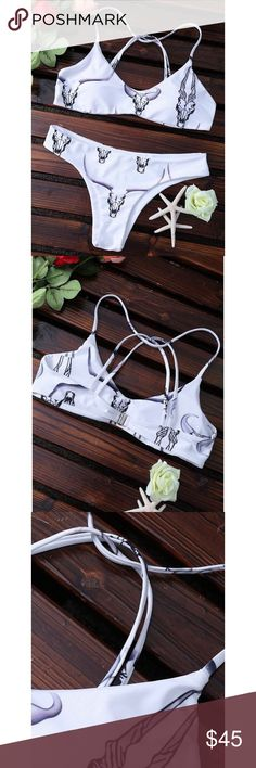 🆕the cross back bralette bikini • style name: the cross back bralette bikini • color: white skull print • v front bralette style bikini w/ strappy cross back • metal hook back closure, padded cups • basic bottoms have minimal coverage • please see sizing guide above • condition: brand new boutique item ____________________________________________________ ✅ make an offer!     ✅ i bundle! ✅ posh compliant closet ⛔️ no trades 🛍 boutique item Swim Bikinis