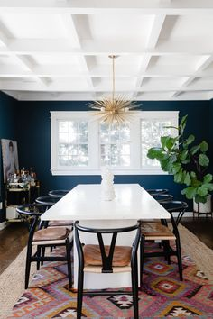 """The dining room is painted in Farrow & Ball's """"Hague Blue."""""""
