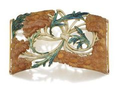 ART NOUVEAU GOLD, CARVED HORN AND ENAMEL NECK PLAQUE, RENÉ LALIQUE, CIRCA 1900. The rectangular plaque of curved form designed as an openwork motif of carved horn chrysanthemums with knotted stems and scrolling leaves decorated in cream and teal enamel, length 4 inches, signed Lalique. With case signed R. Lalique, 40 Cours La Reine, Paris.
